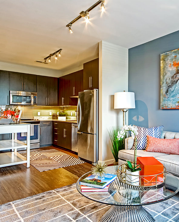View of living room and kitchen in Discovery Square unit