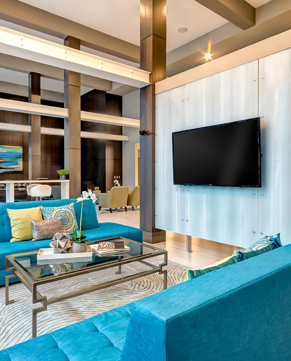 Discovery Square clubroom with seating and TV